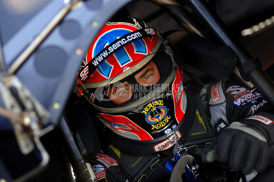 Apr 7, 2006; Las Vegas, NV, USA; NHRA Funny Car champion Gary Scelzi sits in the Mopar Dodge Charger prior to qualifying for the Summitracing.com Nationals at Las Vegas Motor Speedway in Las Vegas, NV. Mandatory Credit: Mark J. Rebilas