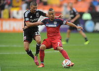 Washington D.C. - March 29, 2014:  Alex of the Chicago Fire shields the ball against Perry Kitchen (23) of D.C. United.  The Chicago Fire tied D.C. United 2-2 during a Major League Soccer match for the 2014 season at RFK Stadium.