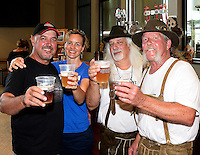 Wisconsin Brewing Company founder Carl Nolen and wife, Kathy Hiteman, toast the creation of Depth Charge Scotch Ale by brewmasters Kirby Nelson and Mike McGuire (L-R) on Sunday, July 12, 2015, in Verona, Wisconsin.