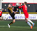 Alloa's Greig Spence goes in high on Cowdenbeath keeper Robbie Thomson.