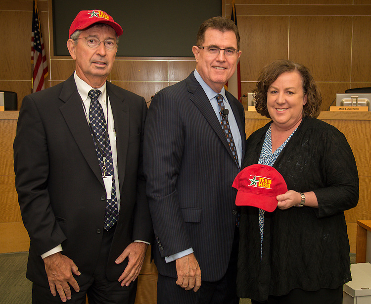 Houston ISD superintendent Dr. Terry Grier presents Ronnie Veselka and Julia Dimmitt with hats during the monthly principals meeting, September 4, 2013.