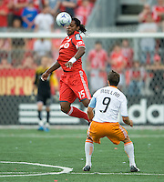 18 July 2009: Toronto FC defender Adrian Serioux #15 handles a ball while Houston Dynamo midfielder Brian Mullan #9 looks on during a game between the Toronto FC and Houston Dynamo..The game ended in a 1-1 draw..