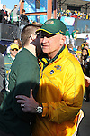 North Dakota State Bison head coach, Craig Bohl, gets some congratulations after winning the FCS Championship game between the North Dakota State Bison and the Sam Houston State Bearkats at the FC Dallas Stadium in Frisco, Texas. North Dakota defeats Sam Houston 39 to 13..