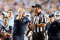 CHAPEL HILL, NC - SEPTEMBER 07: Head Coach Mack Brown of the University of North Carolina disagrees with Line Judge Kirk Lewis during a game between University of Miami and University of North Carolina at Kenan Memorial Stadium on September 07, 2019 in Chapel Hill, North Carolina.