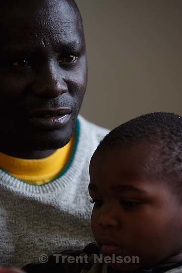 Salt Lake City - Etienne Barabiraho is a refugee from Burundi, and a single parent who now lives in Salt Lake City with his four children. With his 3 1/2 year old son Iranzi Beatrice at right, Barabiraho told his story Tuesday, December 18, 2007.