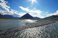 The winding channels of the Marsh Fork of the Canning River, also known as braids, gleam in the midday sun near their confluence with the river's main fork. The river is located in Alaska's Arctic National Wildlife Refuge.