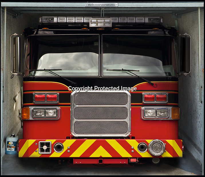 BNPS.co.uk (01202 558833)<br /> Pic: SYG/BNPS<br /> <br /> Keeping ahead of the Joneses...<br /> <br /> New York fire truck.<br /> <br /> Competitive neighbours can now impress the Joneses with a cunning optical illusion that fills the average garage with the transport of dreams.<br /> <br /> Incredible sports cars, yachts, and private jets may not have been the average vehicles in a garage until now - thanks to a set of amazing optical illusion stickers.<br /> <br /> Home-owners can now buy enormous pictures that cover their entire garage doors and make it seem like there are expensive automobiles inside.<br /> <br /> The fantastic pictures show classic cars such as a Mini Cooper, Mercedes S280, 1950 Bentley, 1967 Corvette, Beetle, 1957 MG, and a 1968 Maserati.<br /> <br /> They also depict fantastical items that would have no chance of fitting in a garage, such as aeroplanes like the Blackbird, Hangar, Tomcat, and Learjet.<br /> <br /> The huge tarpaulin-like coverings even feature an array of luxurious yachts, boats, and motorbikes that are sure to impress passers-by and neighbours.<br /> <br /> Each of the huge designs can be put up within 30 minutes to an hour and are fastened in place with velcro so they are easy to remove.<br /> <br /> They fit garages from 8ft by 6.8ft to 16ft by 8ft, can be used on single or multiple doors, and trimmed to size using scissors.<br /> <br /> The stickers cost around 84 pounds each from www.style-your-garage.com.