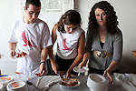 Daniel Santorum, Sarah Maria Santorum, and Elizabeth Santorum, from left, three of Republican presidential hopeful Rick Santorum's seven children, serve pie at a campaign stop on Saturday, August 6, 2011 in Roland, IA.