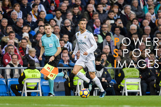 Cristiano Ronaldo of Real Madrid runs with the ball during La Liga 2017-18 match between Real Madrid and Sevilla FC at Santiago Bernabeu Stadium on 09 December 2017 in Madrid, Spain. Photo by Diego Souto / Power Sport Images