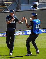 Trent Boult congratulates Adam Milne for catching Eoin Morgan during the ICC Cricket World Cup one day pool match between the New Zealand Black Caps and England at Wellington Regional Stadium, Wellington, New Zealand on Friday, 20 February 2015. Photo: Dave Lintott / lintottphoto.co.nz