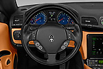 Car pictures of steering wheel view of a 2019 Maserati Gran-Cabrio Sport 2 Door Convertible Steering Wheel