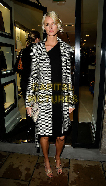 JACQUETTA WHEELER.Flagship store launch party, Michael Kors boutique, London, England. .April 27th, 2009 .full length black white check checked jacket dress clutch bag snakeskin .CAP/CAN.©Can Nguyen/Capital Pictures.