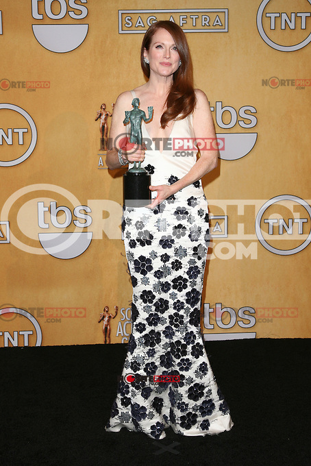 LOS ANGELES, CA - JANUARY 27: Julianna Margulies in the press room at The 19th Annual Screen Actors Guild Awards at the Los Angeles Shrine Exposition Center in Los Angeles, California. January 27, 2013. Credit: mpi27/MediaPunch Inc. /NortePhoto /NortePhoto