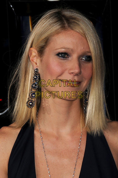 """GWYNETH PALTROW .""""Iron Man"""" Los Angeles Premiere at Grauman's Chinese Theatre, Hollywood, California, USA,.30 April 2008..portrait headshot earrings metal black halterneck dangly sparkly .CAP/ADM/BP.©Byron Purvis/Admedia/Capital PIctures"""