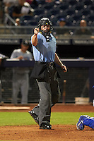 Umpire Carlos Torres makes a call during an Arizona Fall League game between the Glendale Desert Dogs and Peoria Javelinas on October 19, 2015 at Peoria Stadium in Peoria, Arizona.  Glendale defeated Peoria 4-2.  (Mike Janes/Four Seam Images)