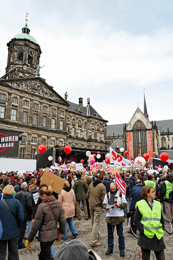 Protester complain about high appartment rents in front of Royal Palace on Dam Square, Amsterdam, Netherlands