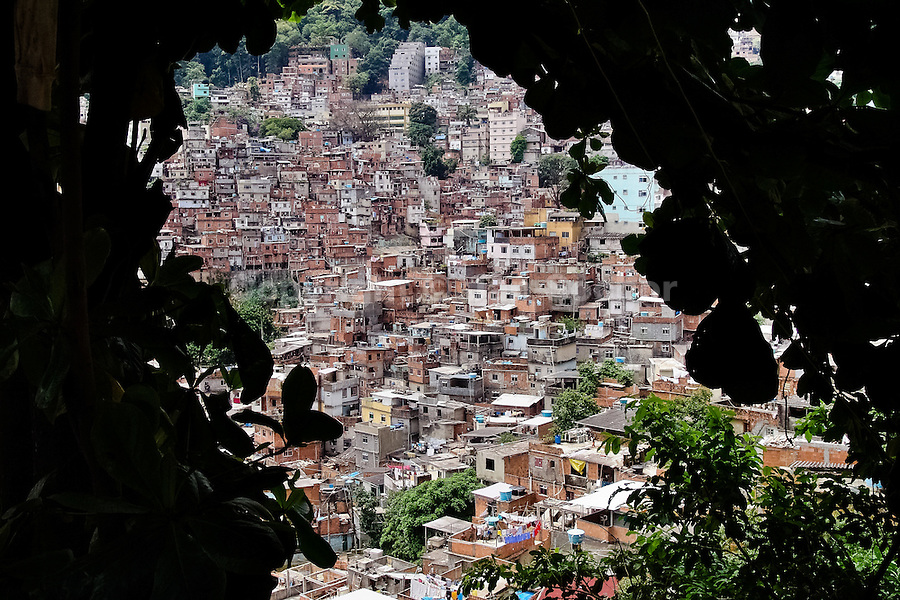 Rocinha, the largest favela in Brazil and one of the most developed in Latin America, built on a steep hillside overlooking the city of Rio de Janeiro, 28 February 2004.