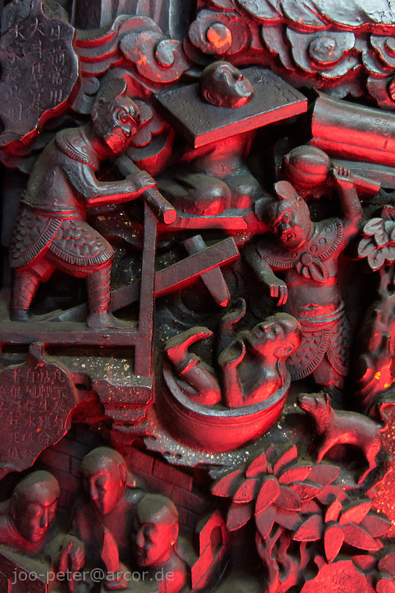 relief wood carving showing torture in hell in Chua Ngoc Hoang temple in Ho Chi Minh City / Saigon,  Vietnam. Taoist temple Phouc Hai Tu (turtle sanctuary) is called Cua Ngoc Hoang (Jade emperor) by the peope. Vietnamese belief is a blend of Buddhism, Taoism and animism