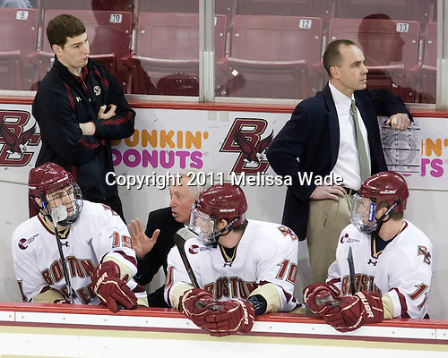 Stephen Greenberg (BC - Senior Manager), Chris Kreider (BC - 19), Jerry York (BC - Head Coach), Jimmy Hayes (BC - 10), Mike Cavanaugh (BC - Associate Head Coach), Pat Mullane (BC - 11) - The Boston College Eagles defeated the visiting University of Massachusetts-Lowell River Hawks 5-3 (EN) on Saturday, January 22, 2011, at Conte Forum in Chestnut Hill, Massachusetts.