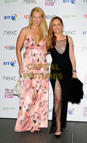 LIZ FULLER & GUEST.Cystic Fibrosis Trust Breathing Life Awards 2008 at the Hilton Metropole Hotel, London, England..May 28th 2008 .full print pink dress halterneck patterned long maxi black sheer slit split hand bag purse white .CAP/CAN.©Can Nguyen/Capital Pictures.