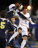 Anthony Ampaipaitakwong #10 of the University of Akron goes up for a header against Kofi Opare #6 of the University of Michigan during the 2010 College Cup semi-final at Harder Stadium, on December 10 2010, in Santa Barbara, California.Akron won 2-1.