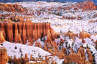 730750126 winter sunrise brightens the red sandstone hoodoos and the sinking ship formation seen from sunrise point in bryce canyon national park utah