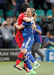 Olympique Lyonnais's Sarah Bouhaddi (r) and Saki Kumagai celebrate the victory in the UEFA Women's Champions League 2015/2016 Final match.May 26,2016. (ALTERPHOTOS/Acero)