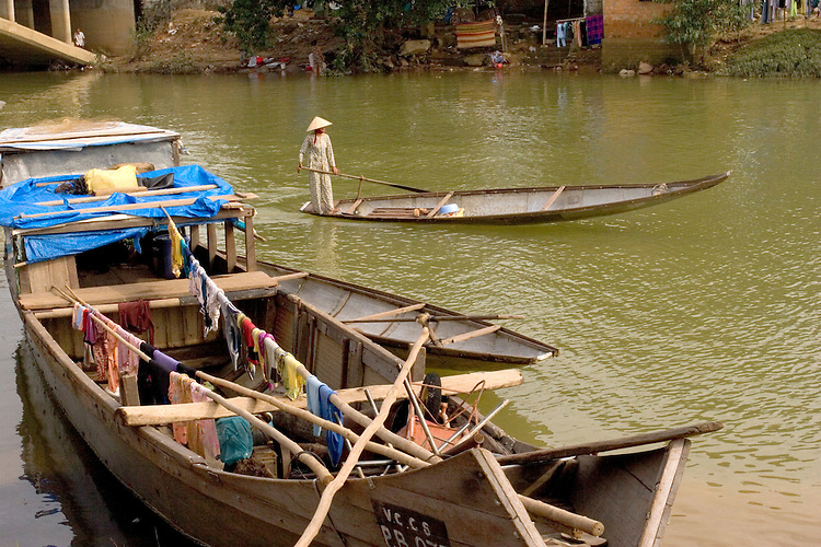 Sanpans serve as transportation and home for Vietnamese living on the Perfume River near Hue, central Vietnam.