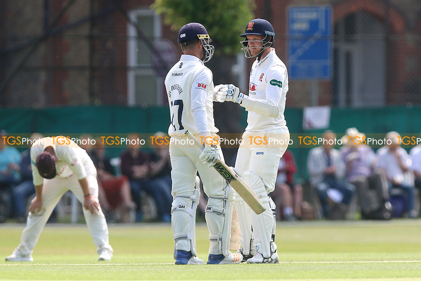 Jamie Porter (R) and Ryan ten Doeschate bump gloves as Essex reach their fifth batting bonus point during Surrey CCC vs Essex CCC, Specsavers County Championship Division 1 Cricket at Guildford CC, The Sports Ground on 11th June 2017