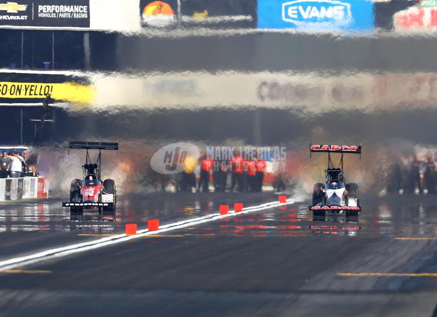 Nov 11, 2018; Pomona, CA, USA; NHRA top fuel driver Richie Crampton (left) races alongside Billy Torrence during the Auto Club Finals at Auto Club Raceway. Mandatory Credit: Mark J. Rebilas-USA TODAY Sports