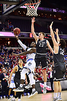 Washington, DC - MAR 11, 2018: Rhode Island Rams guard Jared Terrell (32) shoots a reverse lay up guarded by Davidson Wildcats forward Peyton Aldridge (23) during the Atlantic 10 men's basketball championship between Davidson and Rhode Island at the Capital One Arena in Washington, DC. (Photo by Phil Peters/Media Images International)
