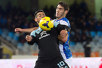 Real Sociedad's Joseba Zaldua (r) and Celta de Vigo's Nolito during La Liga match.November 23,2013. (ALTERPHOTOS/Mikel)