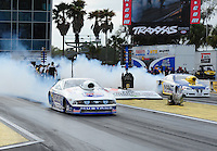 Mar. 10, 2012; Gainesville, FL, USA; NHRA pro stock driver Larry Morgan (near lane) burns out alongside Rodger Brogdon during qualifying for the Gatornationals at Auto Plus Raceway at Gainesville. Mandatory Credit: Mark J. Rebilas-