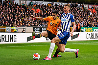 7th March 2020; Molineux Stadium, Wolverhampton, West Midlands, England; English Premier League, Wolverhampton Wanderers versus Brighton and Hove Albion; Raúl Jiménez of Wolverhampton Wanderers and Dan Burn of Brighton & Hove Albion compete for the ball