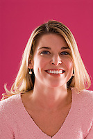 Studio portrait of young blonde Caucasian woman smiling