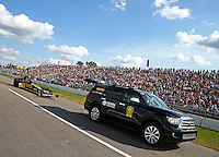 Aug 15, 2014; Brainerd, MN, USA; The Toyota tow vehicle tows NHRA top fuel dragster driver Richie Crampton back to the pits past fans in the grandstands during qualifying for the Lucas Oil Nationals at Brainerd International Raceway. Mandatory Credit: Mark J. Rebilas-