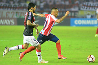 BARRANQUIILLA - COLOMBIA, 05-12-2018:Jarlam Barrera(Der.) de Junior disputa el balón con Luis Gonzalez (Izq.) del Paranaense durante el encuentro entre Atlético Junior de Colombia e Atlético Paranaense de Brasil por la final, ida, de la Copa CONMEBOL Sudamericana 2018 jugado en el estadio Metropolitano Roberto Meléndez de la ciudad de Barranquilla. / Jarlam Barrera (R) of Junior struggles for the ball with Luis Gonzalez (L) of Paranaense during a final first leg match between Atletico Junior of Colombia and Atlético Paranaense of Brazil as a part of Copa CONMEBOL Sudamericana 2018 played at Roberto Melendez Metropolitan stadium in Barranquilla city Atlético Junior de Colombia y Atlético Paranaense de Brasil en partido por la final, ida, de la Copa CONMEBOL Sudamericana 2018 jugado en el estadio Metropolitano Roberto Meléndez de la ciudad de Barranquilla. / Atletico Junior of Colombia and Atletico Paranaense of Brazil in Final first leg match as a part of Copa CONMEBOL Sudamericana 2018 played at Roberto Melendez Metropolitan stadium in Barranquilla city.  Photo: VizzorImage / Alfonso Cervantes / Cont