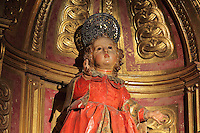 Statue of St Pastor by Torcuato Ruiz del Peral, 18th century, on an altarpiece in the Jesuit Church of Saints Justus and Pastor of Alcala, built 1575 on the site of a mosque in Granada, Andalusia, Southern Spain. Saints Justus and Pastor were 4th century schoolboy christian martyrs, who were killed for their faith under the persecution of the christians by the Roman emperor Diocletian. Granada was listed as a UNESCO World Heritage Site in 1984. Picture by Manuel Cohen