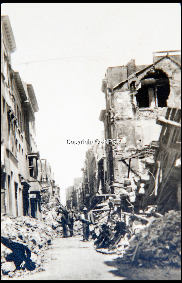 BNPS.co.uk (01202 558833)<br /> Pic: BNPS<br /> <br /> Not far from Dunkirk the city of Ostend received significant building damage.<br /> <br /> Haunting photos which capture the trail of devastation left in the wake of the Dunkirk evacuation have been unearthed after 77 years.<br /> <br /> The poignant pictures were taken soon after 330,000 Allied troops had been rescued from the beaches by an armada of little ships having been defeated by the Germans.<br /> <br /> The epic operation is about to be the subject of the new Hollywood blockbuster movie 'Dunkirk' will stars Tom Hardy and Harry Styles and is die for release on July 21.<br /> <br /> The black and white snaps show German soldiers surveying the wreckage which included destroyed ships and large military trucks lying in the surf.<br /> <br /> They are being sold by Duke's Auctioneers.