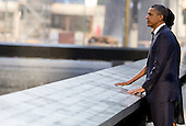 United States President Barack Obama and First Lady Michelle Obama visit the North Memorial Pool at Ground Zero on the 10th anniversary of the September 11 terrorist attacks  in New York, New York on September 11, 2011. The President and First Lady are attending the Commemoration Ceremony at the National September 11 Memorial at the World Trade Center Site as they visit each of the three sites that were attacked. .Credit: Kristoffer Tripplaar / Pool via CNP