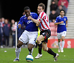 Sunderland's Dean Whirtehead and Everton's Victor Anichebe. during the Premier League match at the Stadium of Light, Sunderland. Picture date 9th March 2008. Picture credit should read: Richard Lee/Sportimage