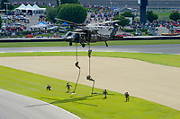 Verizon IndyCar Series<br /> Indianapolis 500 Race<br /> Indianapolis Motor Speedway, Indianapolis, IN USA<br /> Sunday 28 May 2017<br /> Army Rangers drop to the ground to deliver the checkered flags for the race.<br /> World Copyright: F. Peirce Williams<br /> LAT Images