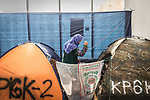 28 August 2019, Jakarta, Indonesia: -An Afghan woman leaves her tent inside the UNHCR refugee centre in Kalideres, Jakarta. Plans to re-locate the overcrowded refugees have been fast tracked after a fight broke out between the groups, many of whom have been in Indonesia for years waiting for placement. Tensions ran high between Afghan and African groups in the centre with a lack of adequate food for the refugees being the catalyst. The African groups, who were moved onto the footpath, were being bussed out today. Conditions in the centre are grim and the local Indonesian population not happy with the refugees presence in the suburb.Picture by Graham Crouch/The Australian