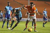 Blackpool's Armand Gnanduillet battles with Wycombe Wanderers' Will De Havilland<br /> <br /> Photographer Alex Dodd/CameraSport<br /> <br /> Checkatrade Trophy Round 3 Blackpool v Wycombe Wanderers - Tuesday 10th January 2017 - Bloomfield Road - Blackpool<br />  <br /> World Copyright &copy; 2017 CameraSport. All rights reserved. 43 Linden Ave. Countesthorpe. Leicester. England. LE8 5PG - Tel: +44 (0) 116 277 4147 - admin@camerasport.com - www.camerasport.com