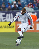 New England Revolution defender Andrew Farrell (2) passes the ball.   In a Major League Soccer (MLS) match, Sporting Kansas City (blue) tied the New England Revolution (white), 0-0, at Gillette Stadium on March 23, 2013.
