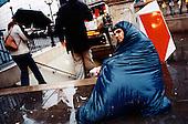 A homeless man begs at London's Oxford Street metro gate..Picture taken 2005 by Justin Jin