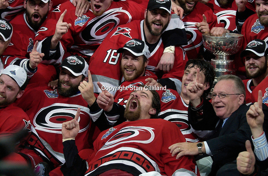 Carolina GM Jim Rutherford joins in the post game team photo. The Carolina Hurricanes beat the Edmonton Oilers 3-1 in game seven to take the Stanley Cup at the RBC Center in Raleigh, NC Monday, June 19, 2006.