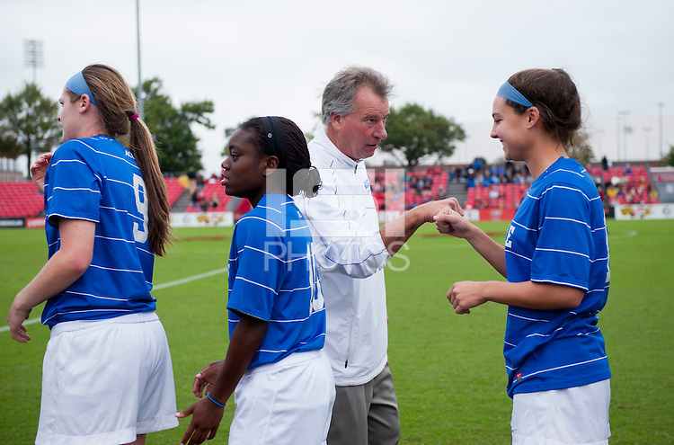 Duke head coach Robbie Church fist bumps Laura Weinberg before the game at Ludwig Field on the campus of the University of Maryland in College Park, MD. DC. Duke defeated Maryland, 2-1.