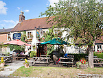 The historic Blue Boar pub on the village green in Aldbourne, Wiltshire, England