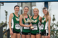 The Mountain Vista girls distance medley relay team pose with their trophy after winning the event in 12:24, just 34/100ths of a second ahead of second place at the 2015 Kansas Relays.
